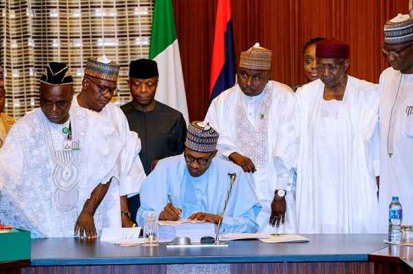 Buhari-signs-2018-budget-to-law